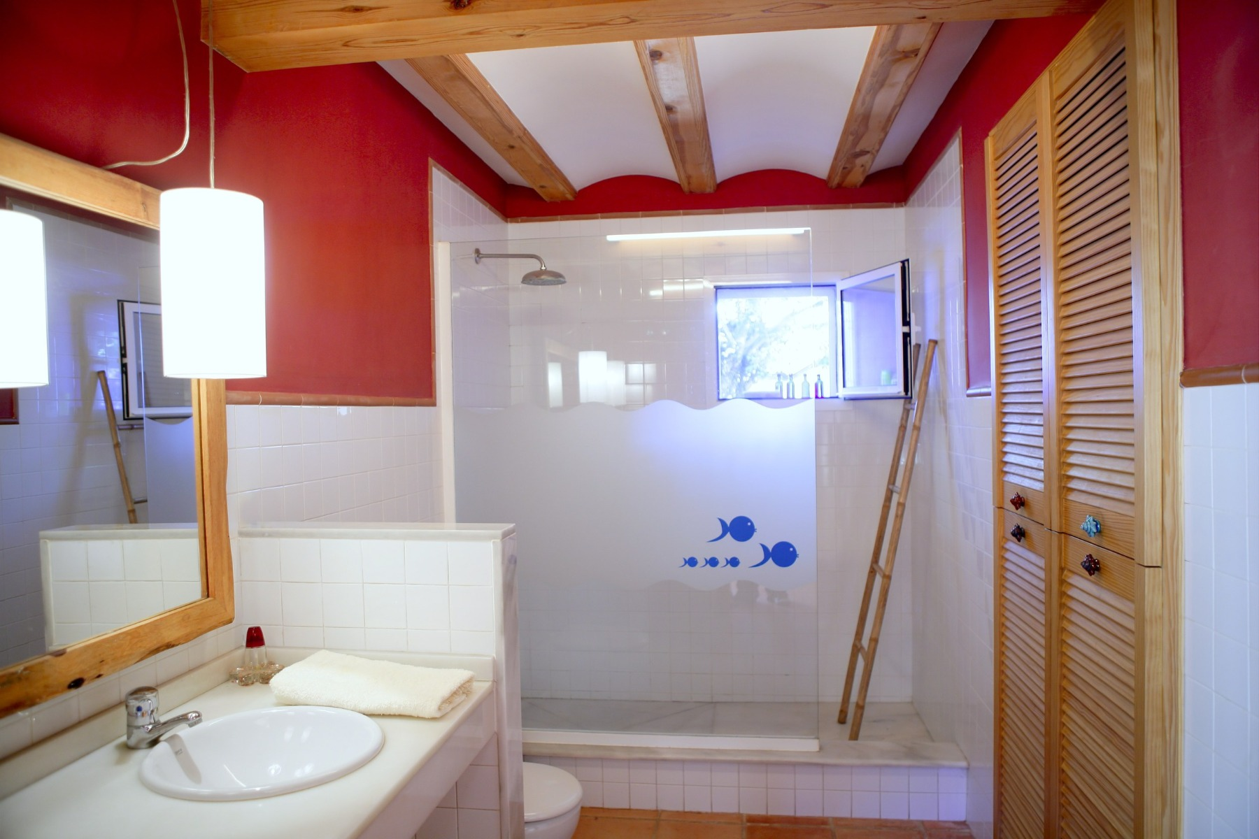 white and red bathroom with wood